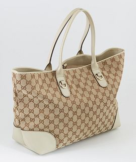 Gucci Beige Monogrammed Canvas and Ivory Leather Heartbit Tote, the exterior with golden brass and bamboo heart charm, opening to a lined beige interi
