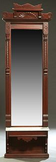 American Aesthetic Period Carved Mahogany Marble Top Pier Mirror, late 19th c., the carved crest over a stepped crown above a rectangular plate flanke