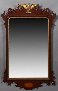English Inlaid Mahogany Chippendale Overmantel Mirror, early 20th c., by Trollope and Colls, London, the scalloped top with a central gilt eagle surmo