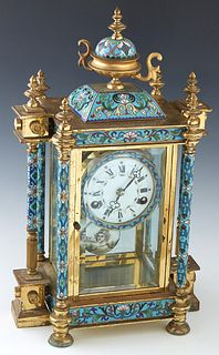 Cloisonne Mantel Clock, 20th c., with an urn surmount over a square cloisonne plinth, above a painted enamel dial, of a time and strike clock, flanked