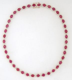 14K Yellow Gold Link Necklace, each of the forty oval links with a graduated oval ruby, atop a border of tiny round white diamonds, total ruby wt.- 43