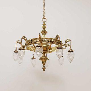 A large brass ten-branch ceiling light,