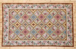 A needlepoint rug,