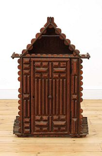A 'tramp art' wall-hanging cabinet,