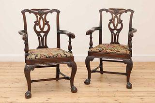 A pair of Irish mahogany open armchairs,