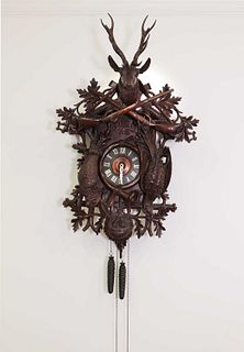 A large carved Black Forest wall-hanging cuckoo clock,