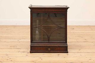 An oak tabletop cabinet,