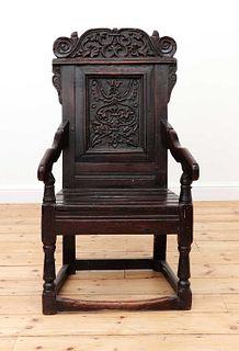 An oak wainscot armchair,