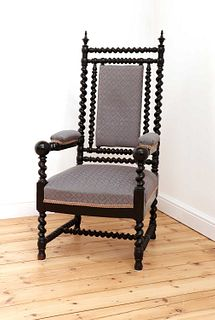 A Victorian ebonised barley twist armchair,