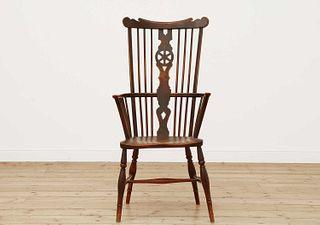 A George III fruitwood and elm high comb back Windsor chair,