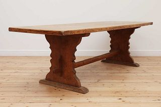 A large refectory table,