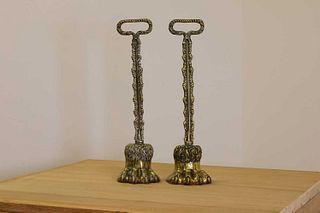 A pair of cast brass door porters,