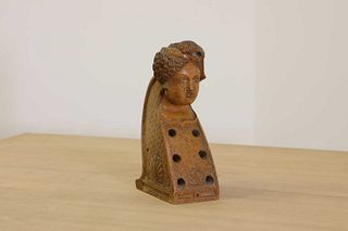 A carved wooden hurdy-gurdy stock head,