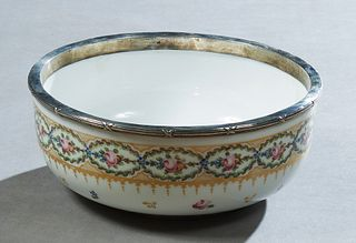 Sevres Style Sterling Rimmed Bowl, 20th c., with a gilt and floral decorated border above gilt leaf and floral decoration, the under side with a spuri