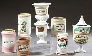 """Group of Eight Ceramic Apothecary Drug Jars, 19th and early 20th c., two with glass labels; """"Vaselinum,"""" and """"Columbae,"""" together with """"Cort. Agued,"""""""
