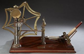 Spinner's Weasel, 19th c., by Goodbrand & Co., Ltd., Manchester, a yarn measuring device, on a mahogany base, said to be the origin of the children's