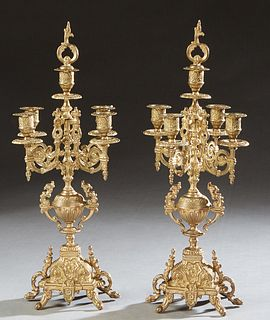 Pair of Italian Brass Five Light Candelabra, 20th c., with a central relief decorated candle cup atop a knopped support issuing four scrolled candle a
