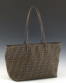 Fendi Tote Bag, with a dark brown zucca coated canvas, and gold brass hardware, opening to a dark pink Fendi pattern interior, H.- 10 in., W.- 17 in.,
