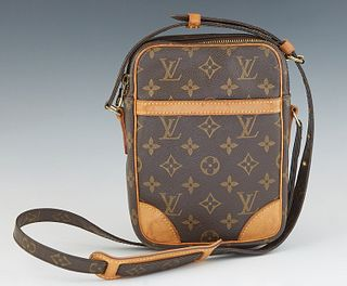 Louis Vuitton Danube Shoulder Bag, in a brown monogram coated canvas, with vachetta leather accents and golden brass hardware, H.- 8 in., W.- 6 in., D