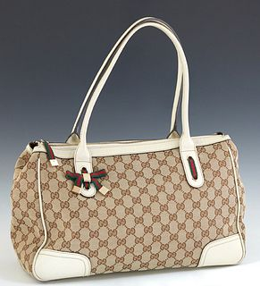 Gucci MM Princy Tote, in beige monogram canvas, with ivory leather and green and red web accents, and gold brass hardware, opening to a brown canvas i