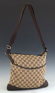 Gucci Medium Messenger Shoulder Bag, in a beige monogram canvas, with dark brown leather and canvas accents, and ruthenium hardware, opening to a brow