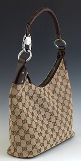 Gucci Braided Handle Hobo Shoulder Bag, in a beige monogram canvas, with dark brown leather accents and ruthenium hardware, opening to a dark interior
