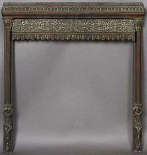Unusual Bronze Fireplace Summer Front Frame, 19th c., New Orleans, the relief scrolled top over a relief leaf and floral panel, above a jagged dentill