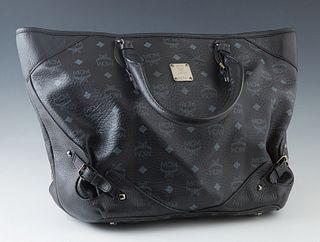 MCM Black Monogram Shopper Bag, with gun metal hardware and zip closure, the interior of the bag lined in black satin monogram print, with a zip closu