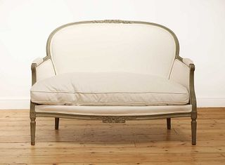 A small French Louis XVI-style settee,