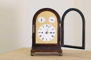 A Regency brass inlaid rosewood mantel clock,