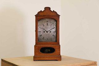 A walnut cased bracket clock,