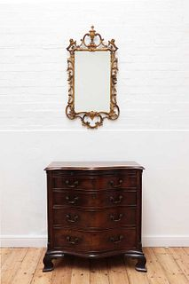 A George III serpentine mahogany chest of drawers,