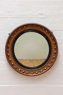 A Regency-style giltwood convex mirror,