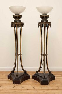 A pair of carved and painted torch?res,