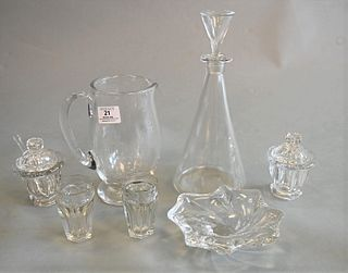 Seven Piece Lot of Baccarat, to include a decanter, a pitcher, a pair of covered sugars, a bowl, along with a pair of small cups, each marked to the b