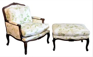 Louis XV Style Fauteuil and Ottoman, each having floral upholstery and carved frames, height 38 inches, width 32 inches.