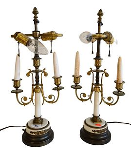 Pair of Neoclassical Style Alabaster Candle Sticks, made into table lamps, having two lights each and round bronze bases, overall height 20 inches.