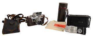 Leica M3 Camera, having Leica Elmar 1:4/135 mm and telescoping lens, some original Leica booklets along with Kodak box camera. Provenance: The Estate