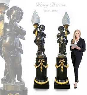 PAIR OF MONUMENTAL HENRY DASSON FIGURAL TORCHIERE LAMP