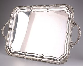 A LARGE 19TH CENTURY SILVER-PLATED SALVER, oval, with egg and tongue border