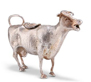 A VICTORIAN SILVER-PLATED COW CREAMER, realistically cast swatting a fly fr