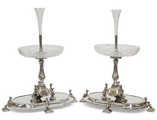 A HANDSOME PAIR OF 19TH CENTURY SILVER-PLATED CENTREPIECES ON MIRRORED STAN