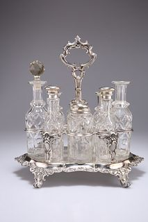 A VICTORIAN SILVER-PLATED EIGHT-BOTTLE CRUET STAND, four bottles with silve