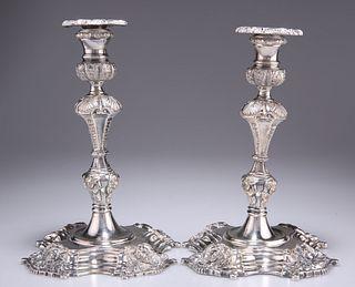 A PAIR OF BAROQUE REVIVAL SILVER-PLATED CANDLESTICKS, 19th Century, each ca