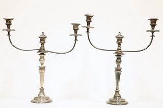 A PAIR OF OLD SHEFFIELD PLATE CANDELABRA, each with twin reeded scrolling b