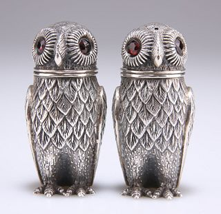 A PAIR OF WHITE METAL NOVELTY PEPPER POTS, each stamped '925' and in the fo