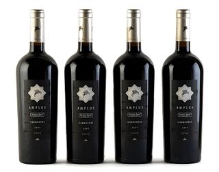 Four Amplus Santa Ema bottles, vintage 2004. Category: red wine, Carmenère. D.O. Valle de Cachapoal. Maipo Island (Chile). Level: A. 750 ml.