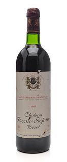 A bottle of Château Beau-Séjour Bécot, 1995. Category: Red wine, Grand Cru. Saint Emilion (France). Level: B. 75 cl.