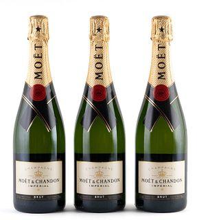 Three bottles Moët & Chandon Brut Impérial. Category: Brut champagne. Épernay, Champagne.