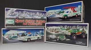 Four Hess Vehicle Toys
